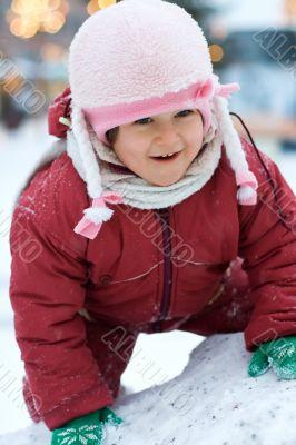 Cute child likes winter fun