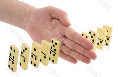 Bones of dominoes and hand