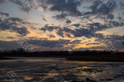 Suns last goodbye on a frozen lake
