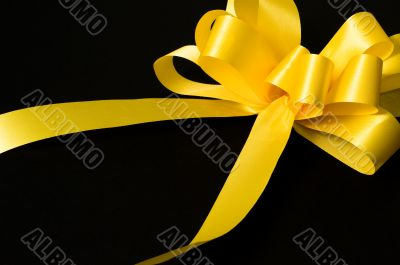 Yellow ribbon for a gift or support