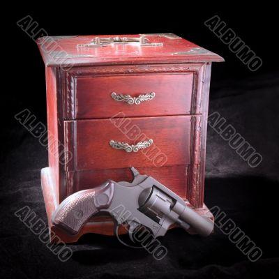 A small box and revolver
