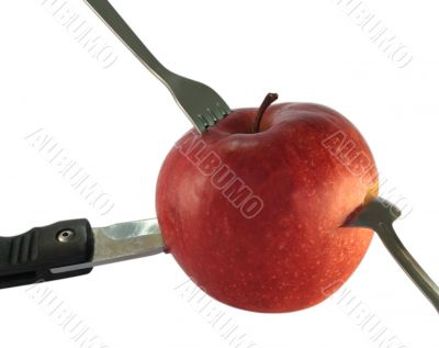 red apple with knife, spoon and fork