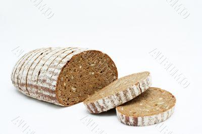 Sliced loaf of cereal bread.