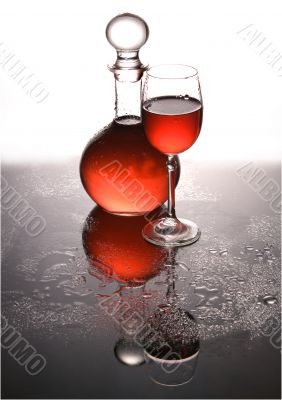 Carafe and a glass with wine.
