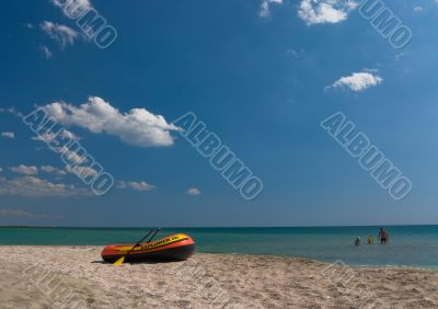 Seashore with an inflatable boat and sea