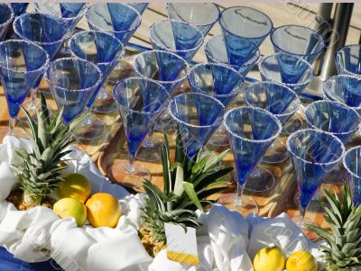 Margarita glasses lined up on a table