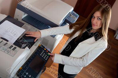 Young business woman at photocopier