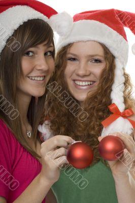 Christmas, happy teenagers with Christmas tree ball