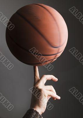 Basketball rolling on finger