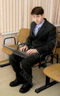 Person in a suit with the laptop