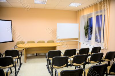 Interior of a conference hall in pink tones