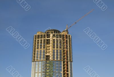 Cranes and building construction of a skyscraper early morning a