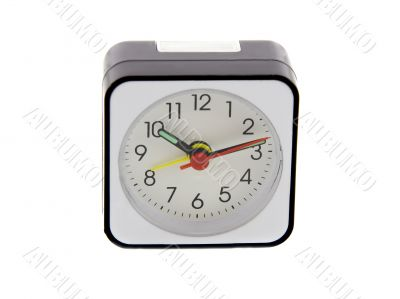 Modern alarm clock isolated over white. Time is 10.12 a.m.