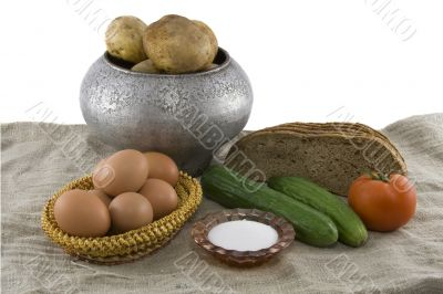 Still-life from vegetarian food. Fresh cucumbers, eggs lying in