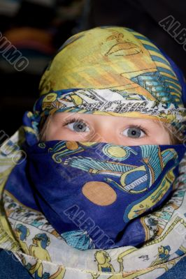 Curious child dressed in Arabian headscarf