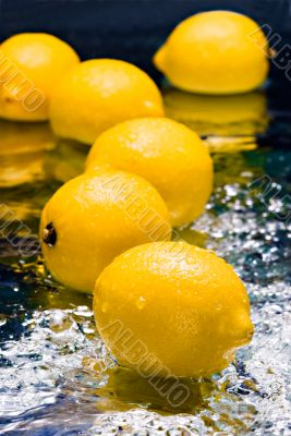 lemons on thin layer of water