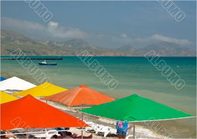 Colorful sunshades at the seashore.