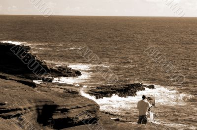 Artist painting at Makapu`u Beach Hawaii sepia