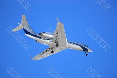 Landing Aeroplane on a blue background