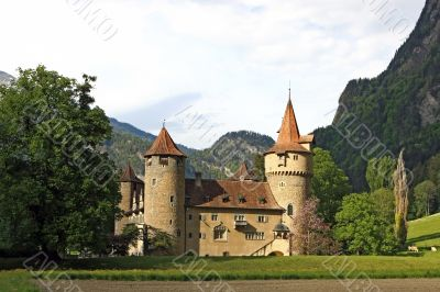 Castle in front of a mountain scenery