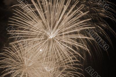 Fireworks lighting the skies sepia