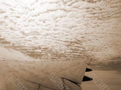 Aeroplane High in the Clouds sepia