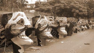 Ravana head effigies on the street sepia