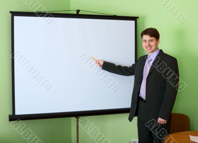 Businessman near the white screen