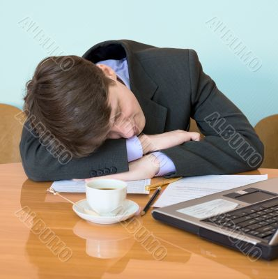 Businessman has fallen asleep sitting at meeting