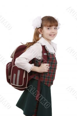 School girl with schoolbag. Education.