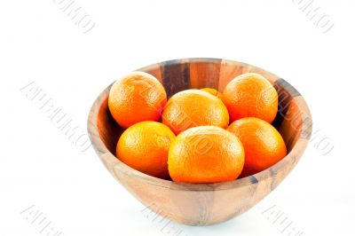 wood dish full with oranges