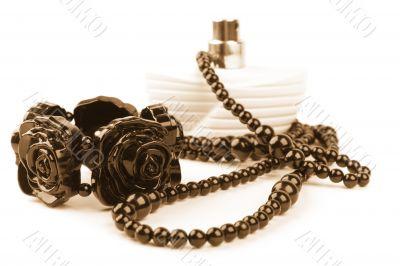 necklace, bracelet and parfume bottle