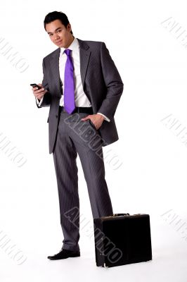 Portrait of a strong young indonesian man in a suit with phone
