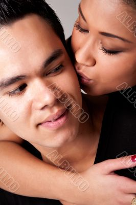 Gently kissing my Indonesian lover on his cheek