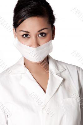 Beautifull Indonesian nurse ready for examining