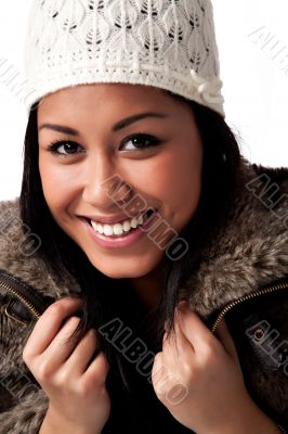 Young beautifull African woman with white knitted cap