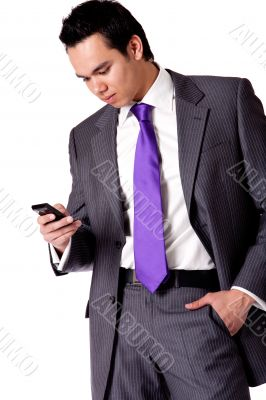 Strong young indonesian man in a suit checking his phone