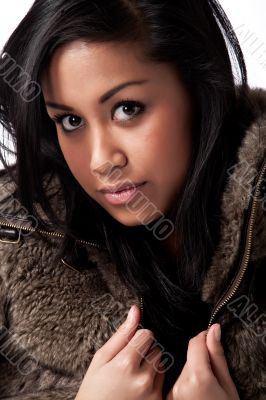 Young beautifull African woman in fur jacket