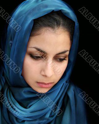 Arab girl in blue scarf
