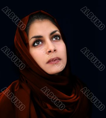 Arab girl in red scarf