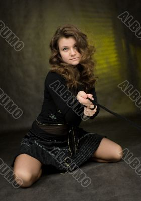 Girl in black on dark background