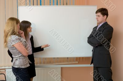 Office workers discuss work