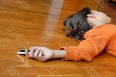 Teen girl lying on floor