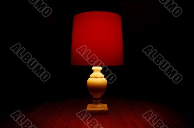 Red Light On A Table In Darkness