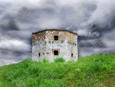 Old stone tower over cloudy sky
