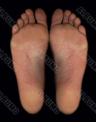 Barefoot feet with black background