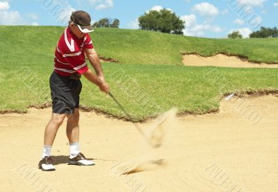 Senior golfer playing golf from sand bunker