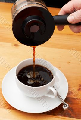 Closeup of coffee being poured into the cup
