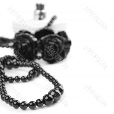 black necklace, bracelet and parfume