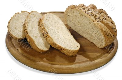 isolated bread with grains on a board